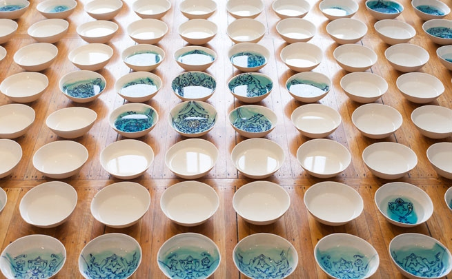 Soheila Esfahani, <i>Wish on Water</i> (2014), 120 glazed porcelain bowls, water, dimensions variable.