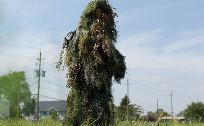 Alana Bartol, <i>Un-Camouflaging #7</i> from the series <i>Forms of Awareness: Ghillie Suit</i>, netting, synthetic fiber, weeds, and grasses common to Southwestern Ontario.